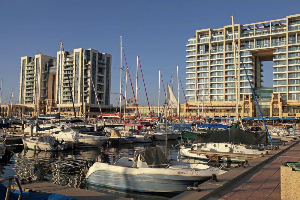 Herzliya , Israel - August 25, 2015: Sailing yacht, promenade and The Ritz-Carlton Herzliya Hotel in Herzliya Marina, Israel. It's the largest and luxury marina in Israel.